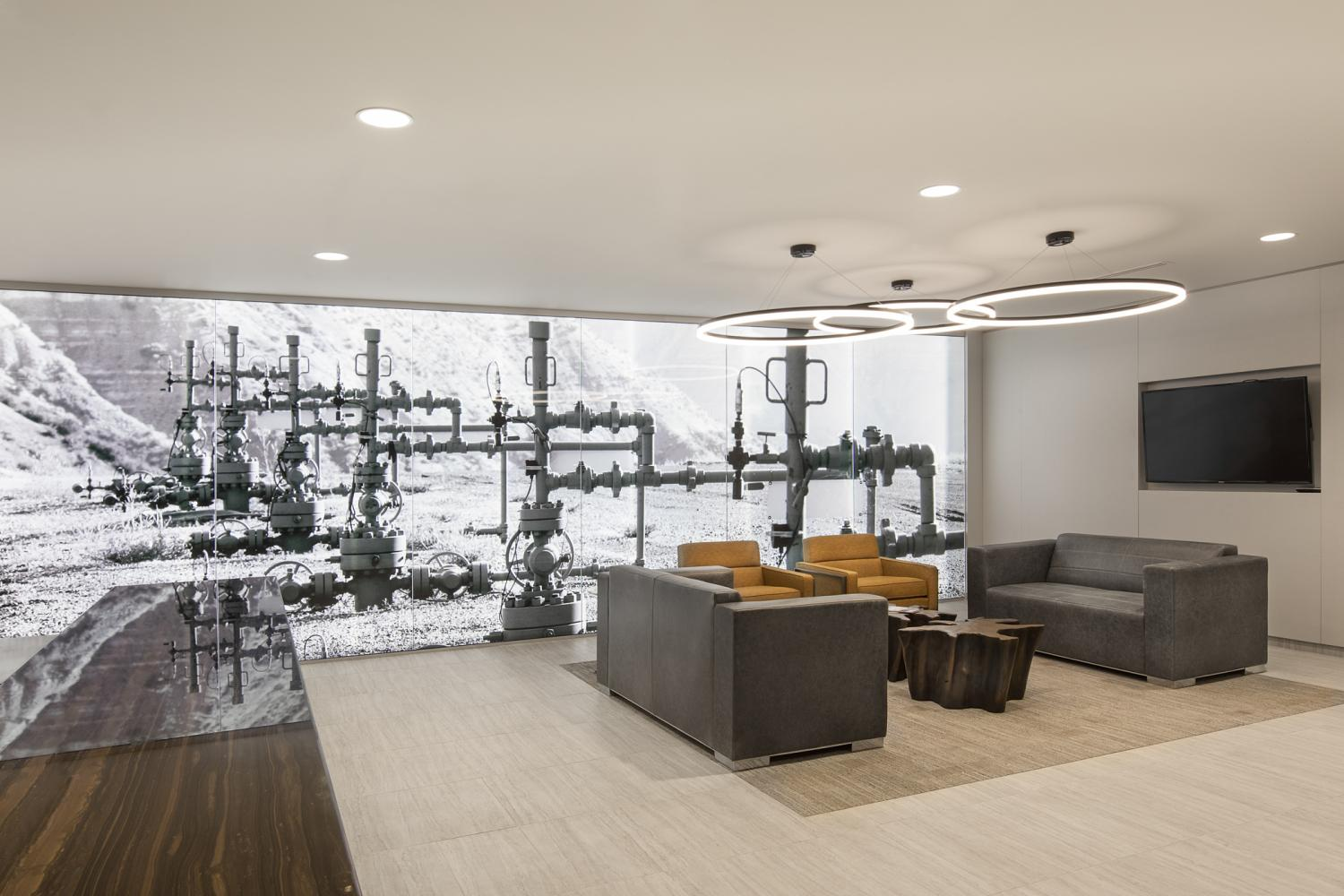 Caerus Oil and Gas Reception Area with Backlit Photo Commercial Construction Denver Colorado