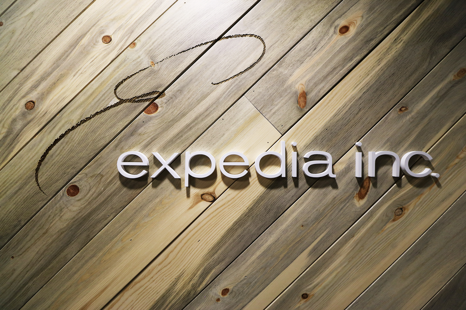 Expedia Logo Beetle Kill Wood Commercial Construction Denver Colorado