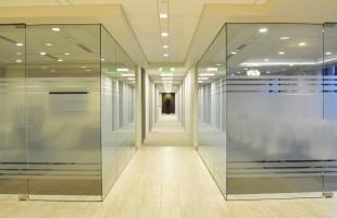 D A Davidson Hallway Lined with Glass Rooms Denver CO