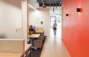 Kentwood Real Estate Break Room and Collaboration Area with Red Wall Commercial Construction Denver Colorado